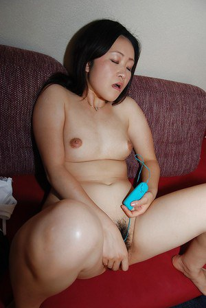 Splendid Asian brunette Takako Makino is a frisky milf with hairy cunt