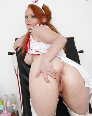 Appealing fetish babe in uniform Samantha frolics with red dildo
