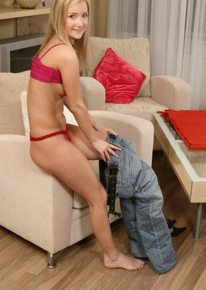 Slippy blonde cutie in jeans undressing and fingering her sweet pussy