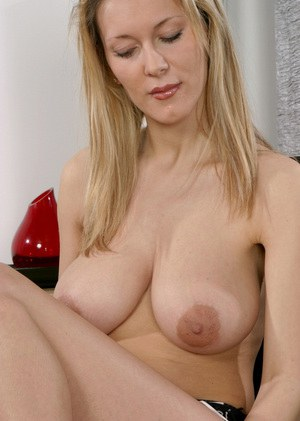 Naughty blonde MILF revealing her massive tits and pink pussy
