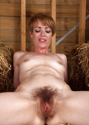 Short-haired MILF uncovering her slim curves and exposing her bush