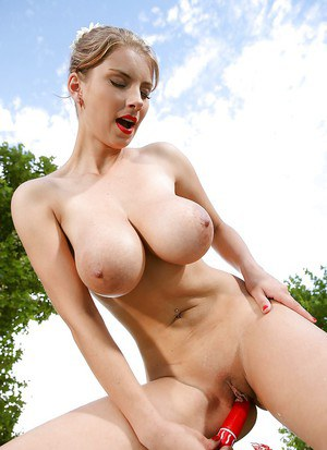 Foxy babe with amazing natural melons undressing and toying her cunt outdoor
