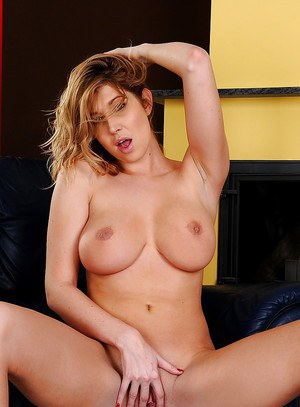 Desirable blonde with big bosoms undressing and teasing her shaved pussy