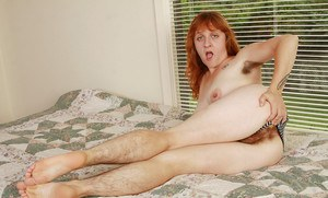 Ugly redhead MILF undressing and exposing her hairy armpits and twat
