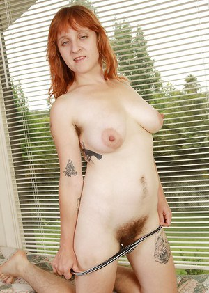 Ugly lassie with unshaven armits undressing and spreading her hairy gash