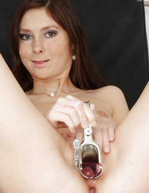 Graceful brunette cutie playing with a speculum and pissing