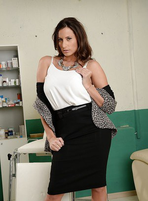 Curvy MILF in dress clothes stripping down and squeezing her big jugs