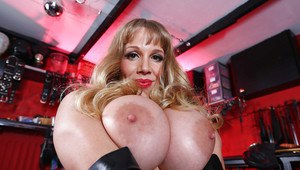 Top-heavy blonde MILF with big ample ass posing in sexy fetish outfit