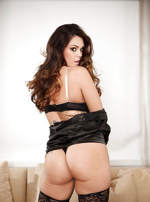 Pornstar babe Alison Tyler loves wearing stockings and oiling her tits