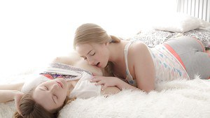 Adorable european lesbian teenies make some hot action on the bed
