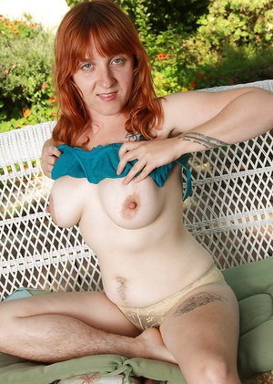 Lusty redhead lassie with hairy legs reveals her saggy jugs and bushy cunt