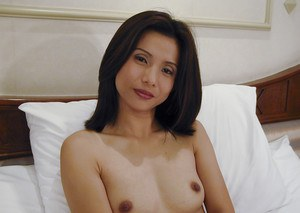 Kinky Asian babe with tiny tits Tukta covers precious spot on her body