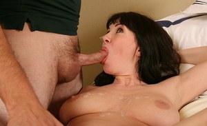 Sultry brunette MILF gives a sensual blowjob on a swollen cock