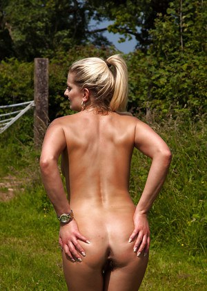 Hairy mature courtesan Samantha Snow lies naked on a green lawn