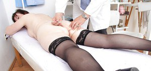 Fatty mature gal with massive melons goes through her gyno examination
