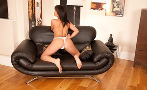 Luscious brunette with sexy feet undressing and spreading her pussy