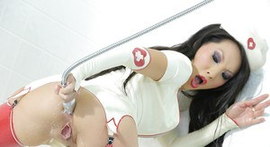 Asian nurse in latex stockings performs a hot both holes masturbation scene