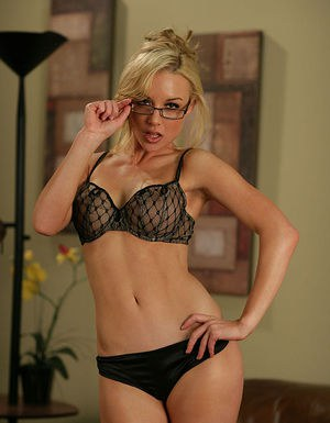 Ravishing blonde in nylons and glasses getting rid of her lingerie