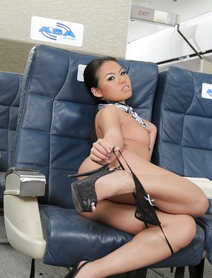 Sassy asian flight attendant getting nude and exposing her goods