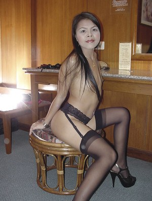 Salacious tattooed thai slut in stockings exposing her goods