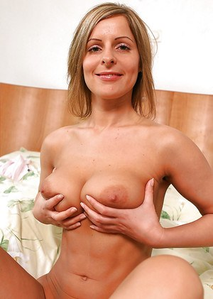Graceful blonde amateur getting naked and squeezing her ample bosoms