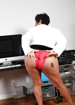 Fatty latina mature gal exposing her butt and juicy gash at her workplace
