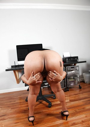 Mature latina gal in dress clothes uncovering her saggy tits and big butt