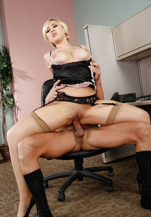 Curvy blonde in nylons has some cock fucking fun with her office mate