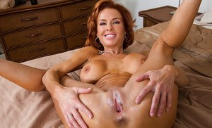 Big busted redhead mom gives head and gets her hungry pussy drilled