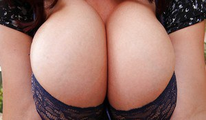 Crummy lusty milf Joanna Bliss is caressing her giant tits and puss
