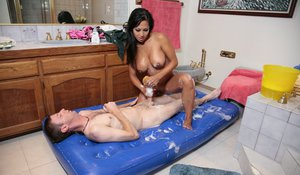 Big busted asian lassie gives a proper wet and soapy erotic massage