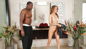 Graceful tattooed masseuse playing with her client's big black tool