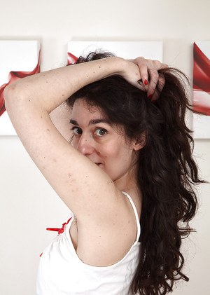 Ugly hairy pussy by mature brunette with hairy armpits and tiny tits.