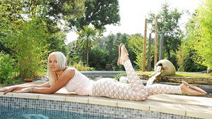 Poolside foot fetish by exciting European blonde babe with long legs.
