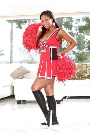 Slutry Ebony cheerleader with big tits spreads her pussy lips.