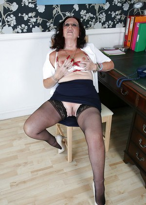 Mature secretary Zadi with slutty ass and big tits spreading her legs