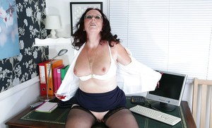 Mature secretary named Zadi in hot stockings shows off her hairy pussy