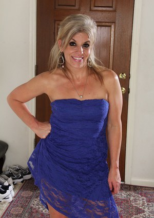 Mature blonde Sierra Smith with tiny tits takes off her blue dress