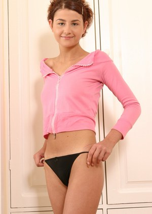 Pretty amateur teen Olga with flexible body poses naked on the floor