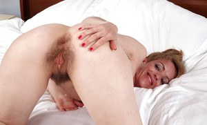 Short-haired mature Marie with pale skin and super hairy pussy