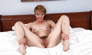 Short haired mature Maria demonstrates her dangerously hairy pussy