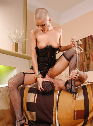 Crazy bald slut C.J. in hot stockings presents awesome footjob