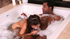 Gorgeous Asian girl Jackie Lin is rubbing hard cock in a bath