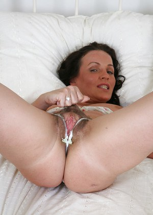 Mature lady Marlyn is taking off her sexy panties and showing her hairy cunt