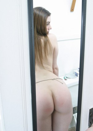 Teen babe with provocative eyes and huge ass poses in the toilet