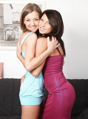 Two pretty lesbian teens Megan and Inna kissing and licking sweet