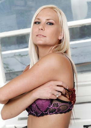 Blonde milf Elizabeth takes pretty lingerie and poses on the gas-stove