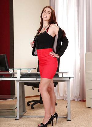 Engaging big titted babe Vica poses naked right in her office