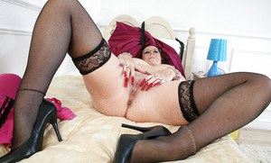 Mature woman Zadi in glasses and stockings spreads her hungry pussy