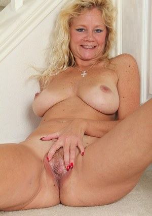 Slutty mature blonde Ali Jones has nice big boobs and young pussy